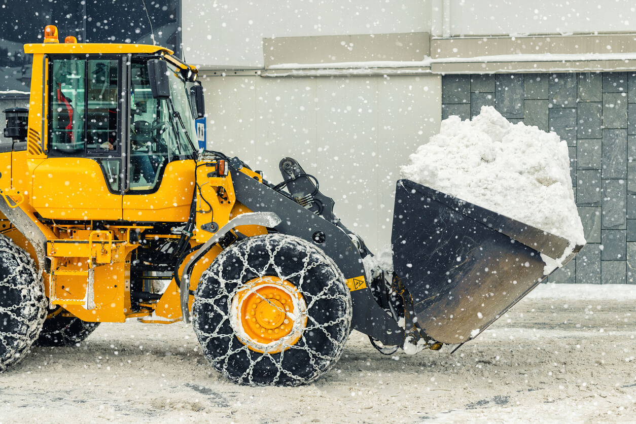 tractor in the snow on a construction site